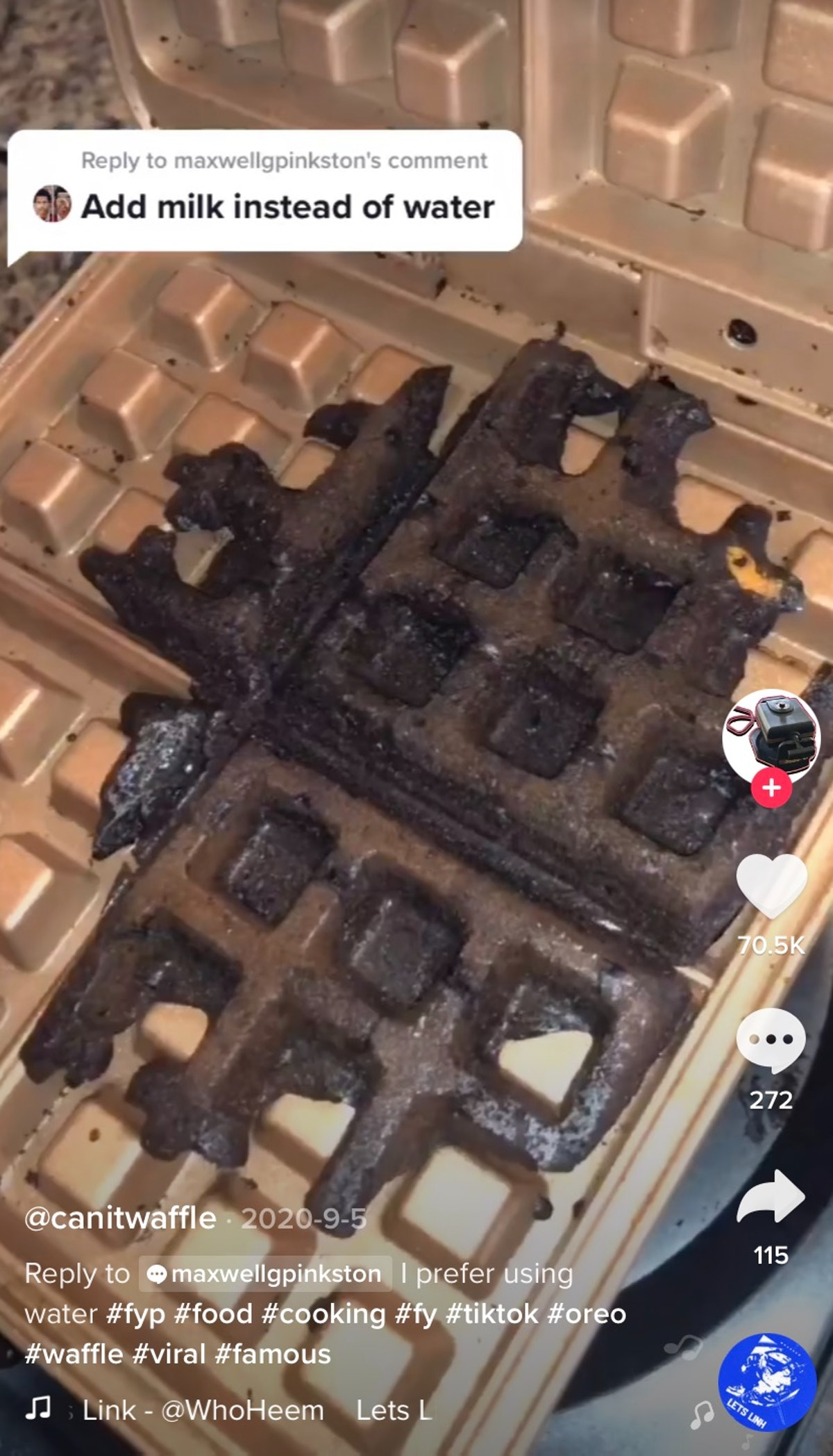 An Oreo waffle cooks in a waffle maker.