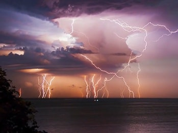 An image of lightning striking over a body of water