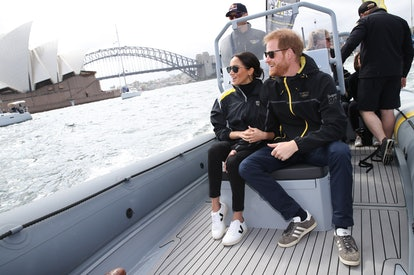Prince Harry, Duke of Sussex and Meghan, Duchess of Sussex on Sydney Harbour looking out at Sydney Opera House and Sydney Harbour Bridge during day two of the Invictus Games Sydney 2018 at Sydney Olympic Park on October 21, 2018 in Sydney, Australia.
