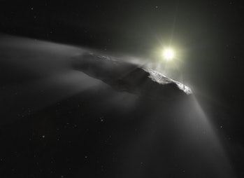 A comet giving off a vapor trail as it passes in front of the sun