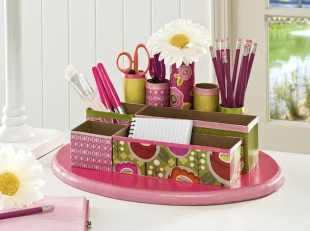 Make a desk organizer with toilet paper rolls and cereal boxes.