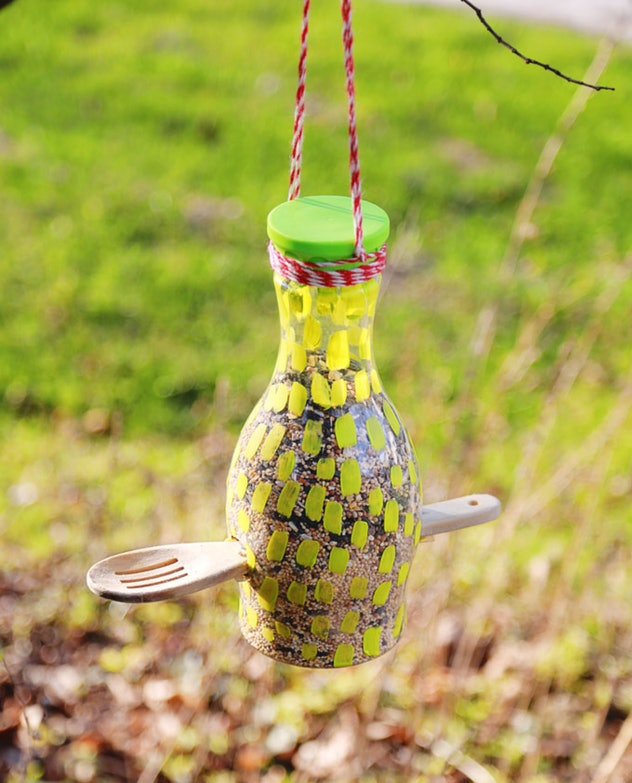 A bird feeder made out of a recyclable bottle.