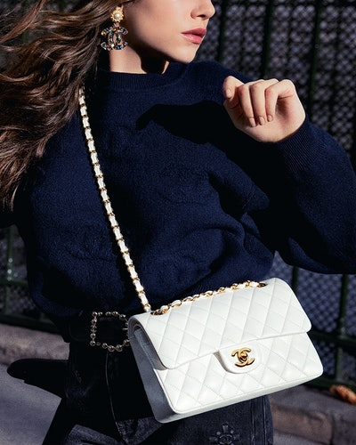 woman carrying chanel bag