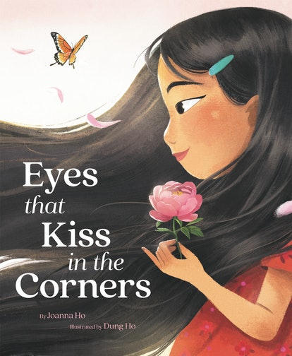 The cover of Eyes That Kiss In The Corners, featuring a beautiful illustration of an Asian girl holding a pink flower.