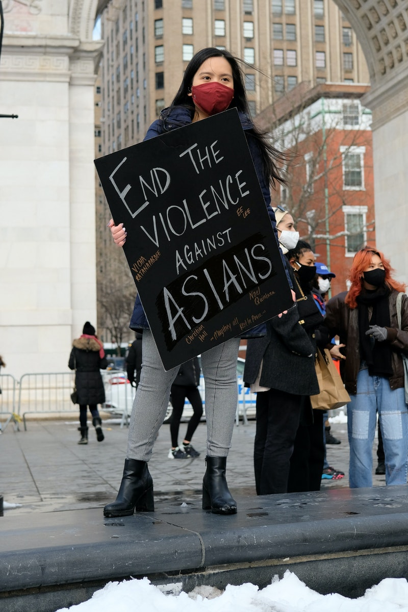 woman at a protest in Washington Square Park