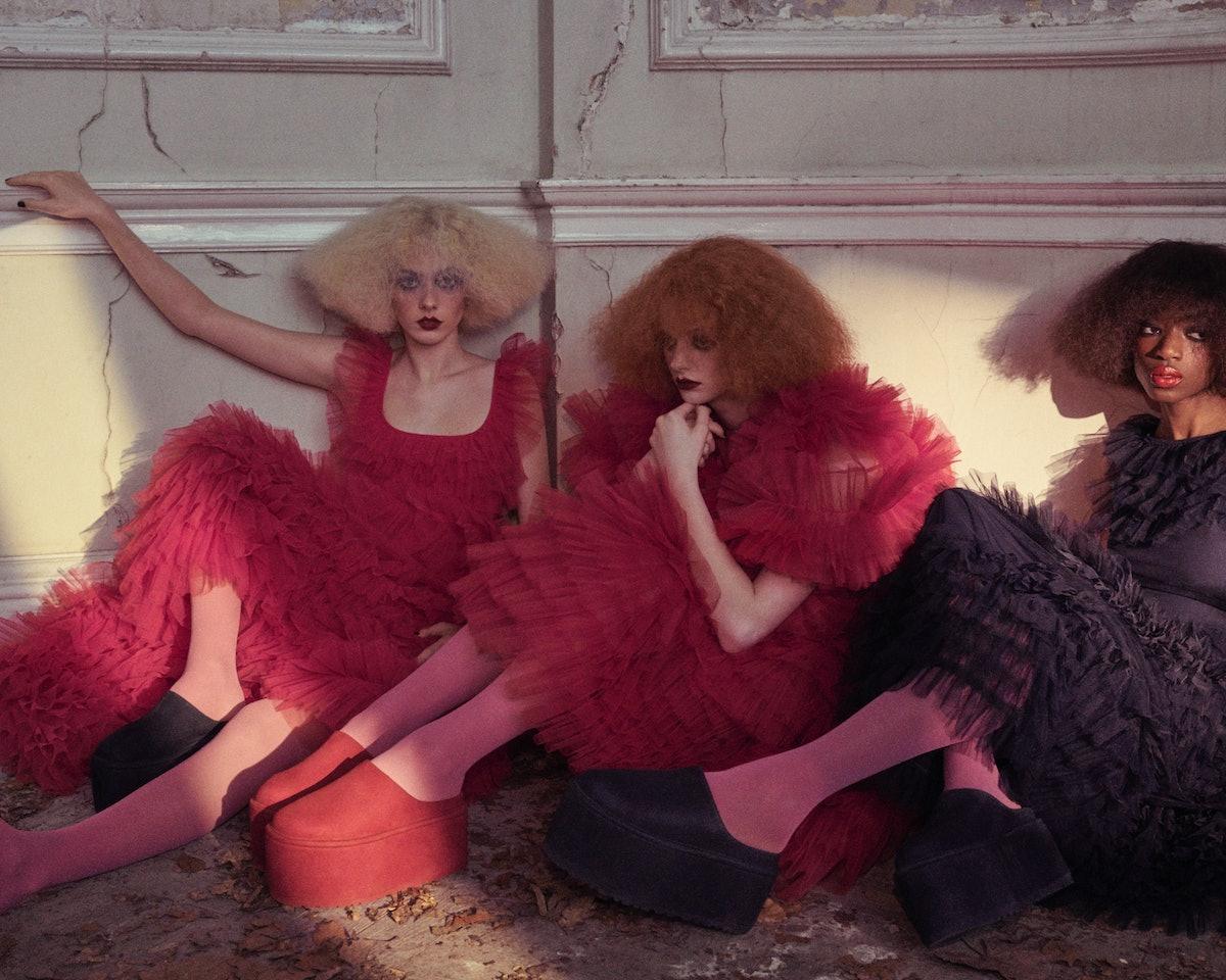 Three models wearing Ugg x Molly Goddard platforms