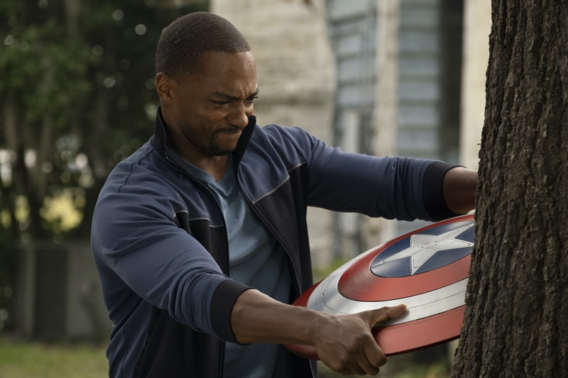 Sam Wilson with the Captain America shield on 'Falcon and the Winter Soldier' via the Disney+ press ...