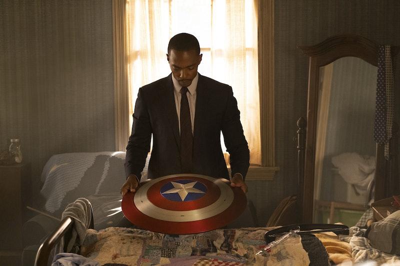 Sam Wilson considers Captain America's shield in 'The Falcon & The Winter Soldier.' Photo via Disney