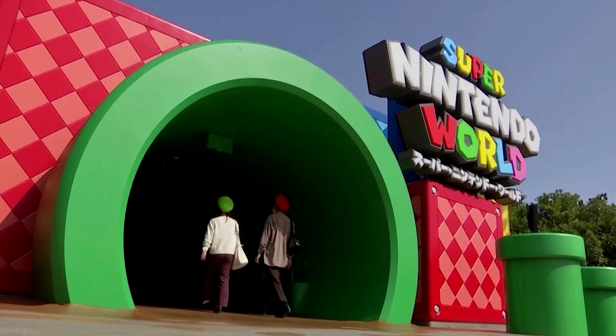 Two people enter a warp pipe