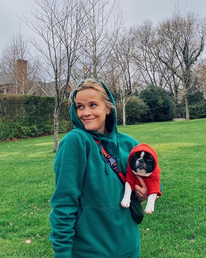 Reese Witherspoon and her dog pose in a photo from Instagram.