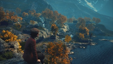 A boy looking out on a mountainscape.