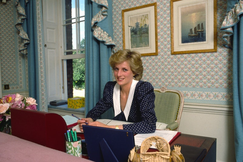 Princess Diana at her desk, writing letters