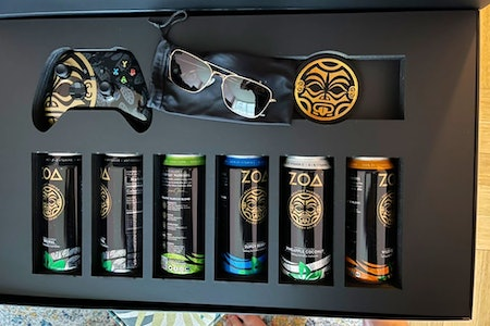 A photo of the every drinks, branded controller, and sungalsses.