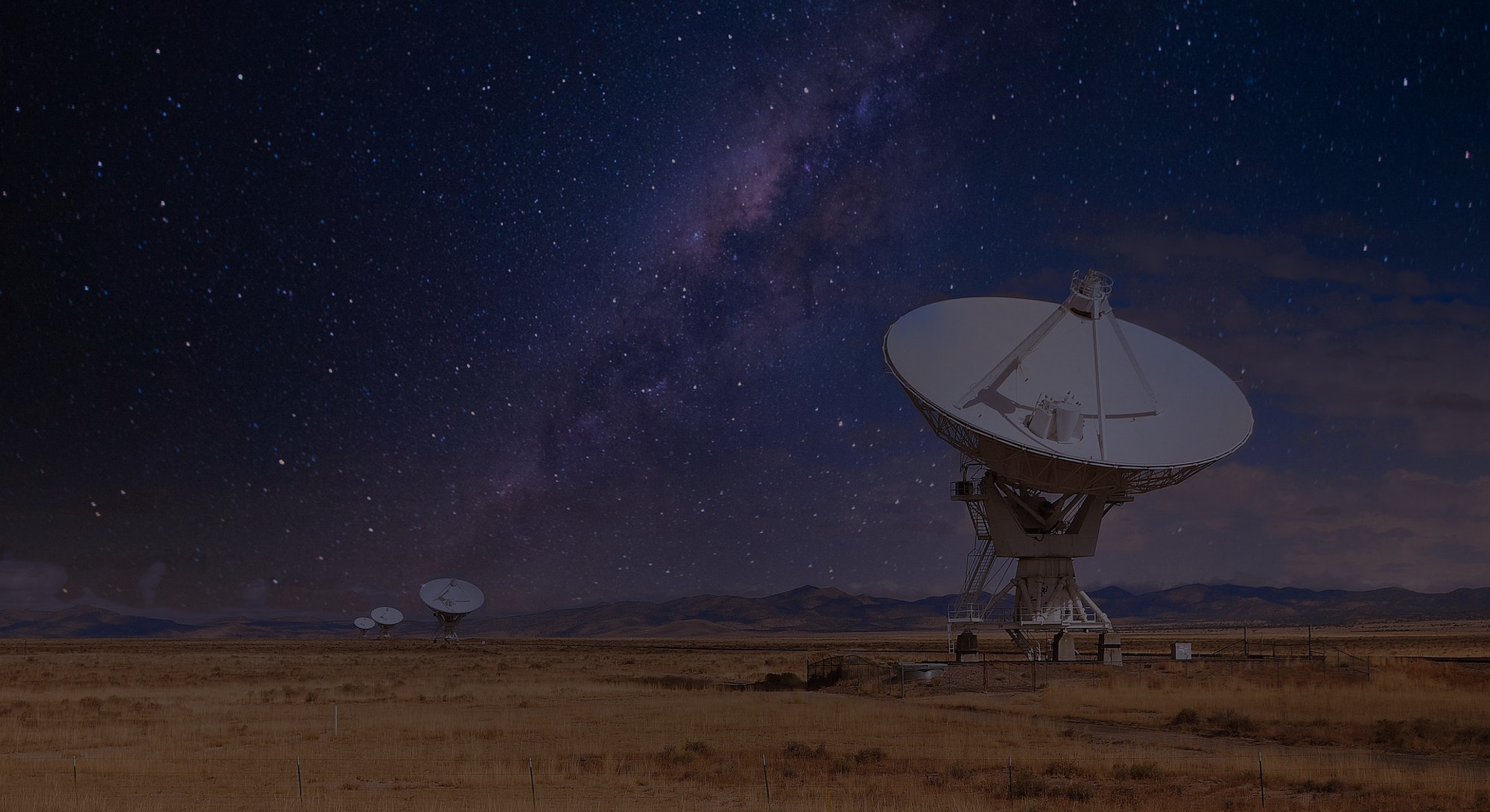 The Very Large Array telescope with a starry background
