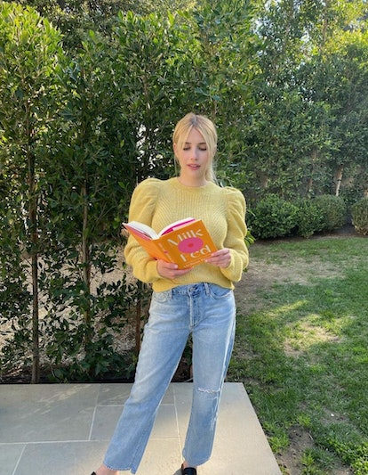 Emma Roberts reading a book.