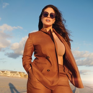 Ashley Graham wearing a pair of sunglasses from the Ashley Graham x Quay  collaboration.