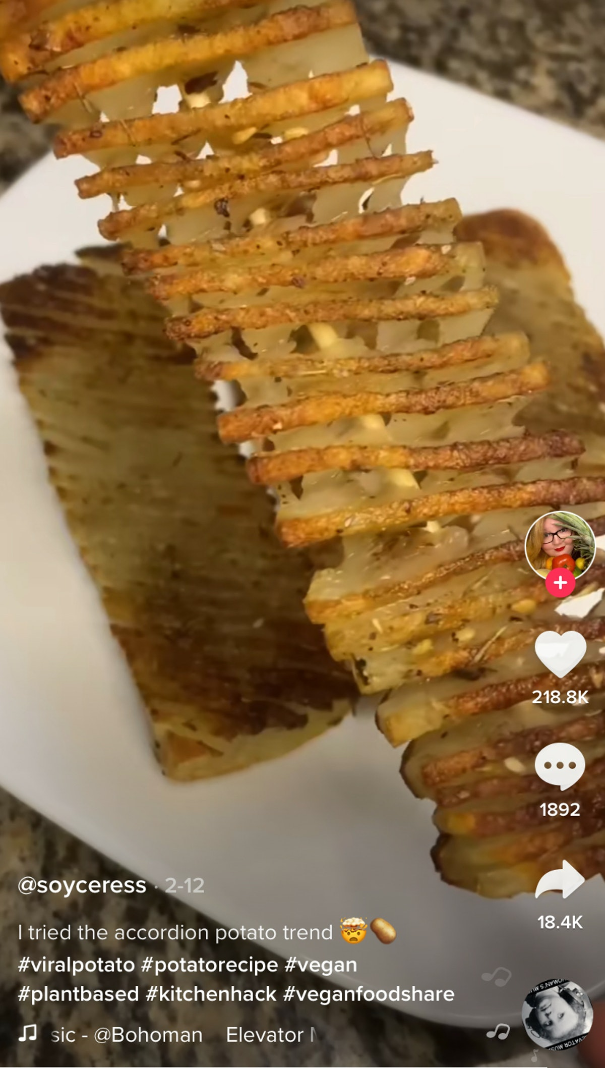 A woman makes accordion potatoes on skewers at home.