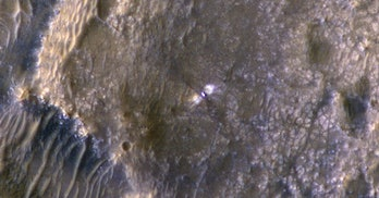 An image of the surface of Mars with the Perseverance rover shown in the center.