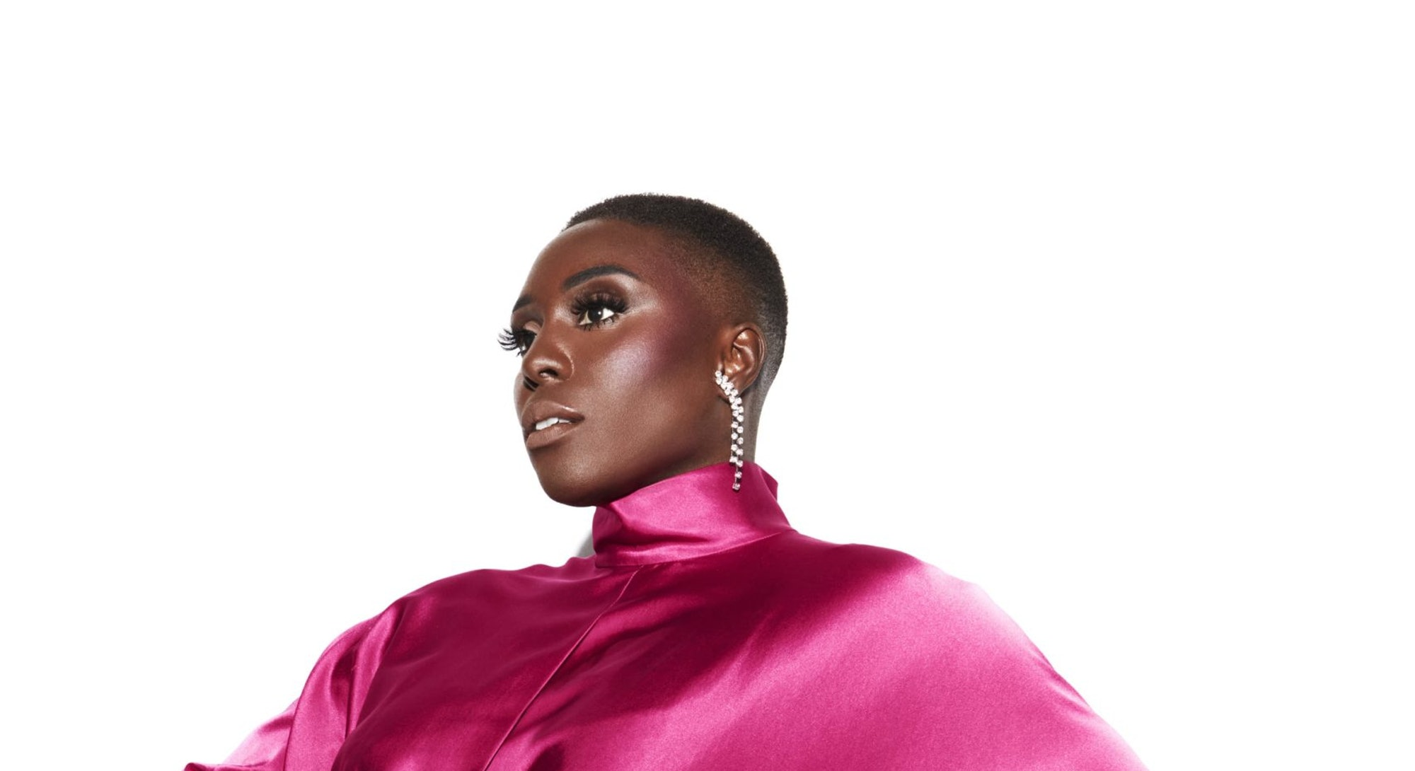 A portrait of Laura Mvula in a pink satin dress.