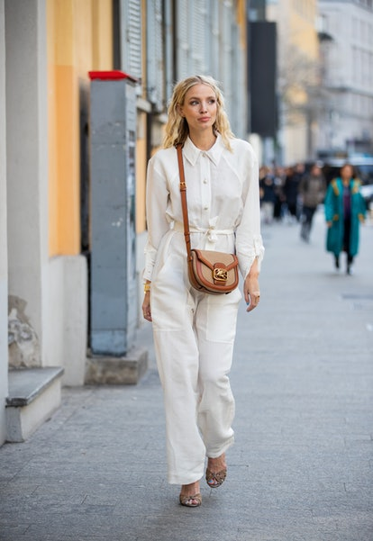 Leonie Hanne is seen wearing white button shirt and pants, brown bag outside Etro during Milan Fashion Week Fall/Winter 2020-2021 on February 21, 2020 in Milan, Italy.