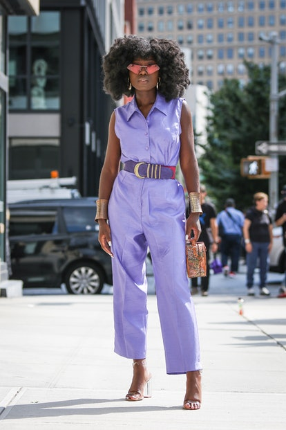 A guest is seen wearing a purple romper during New York Fashion Week on September 09, 2019 in New York City.