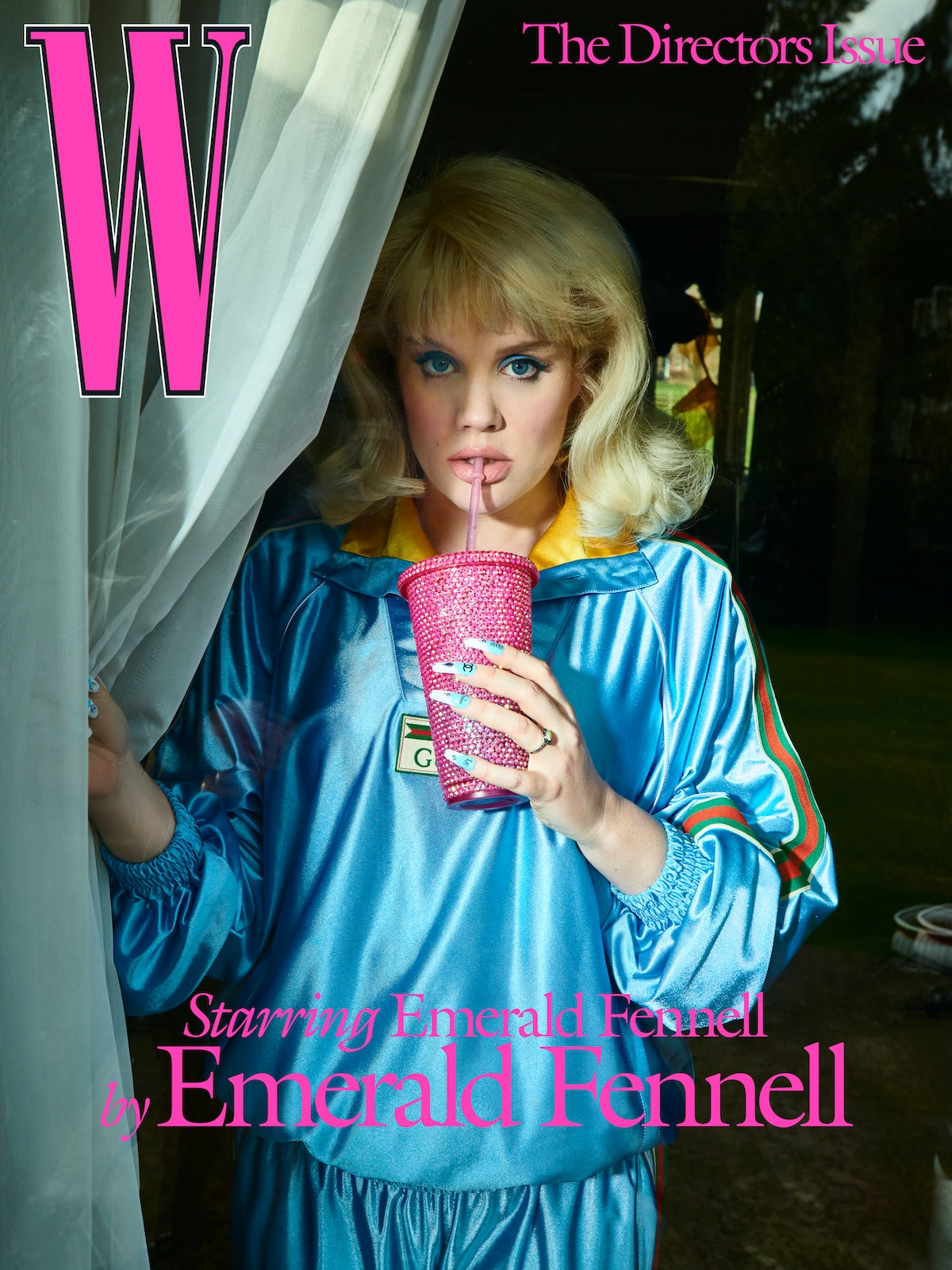 Emerald Fennell wears a Gucci sweatshirt and pants; Theo Fennell rings. TheBlingBabyy custom cup.