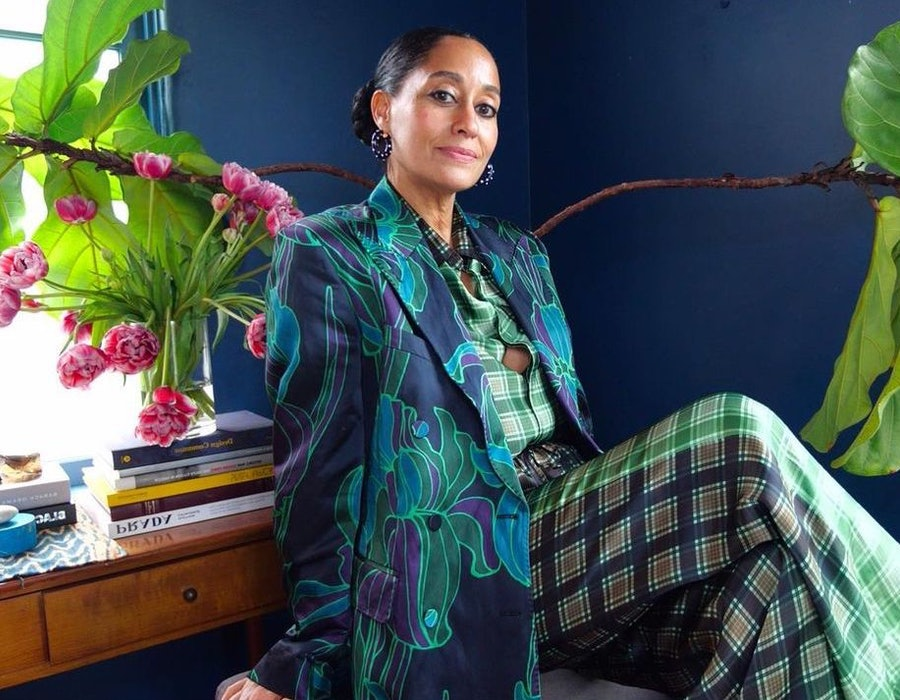 Tracee Ellis Ross in a plaid green suit and blue blazer.