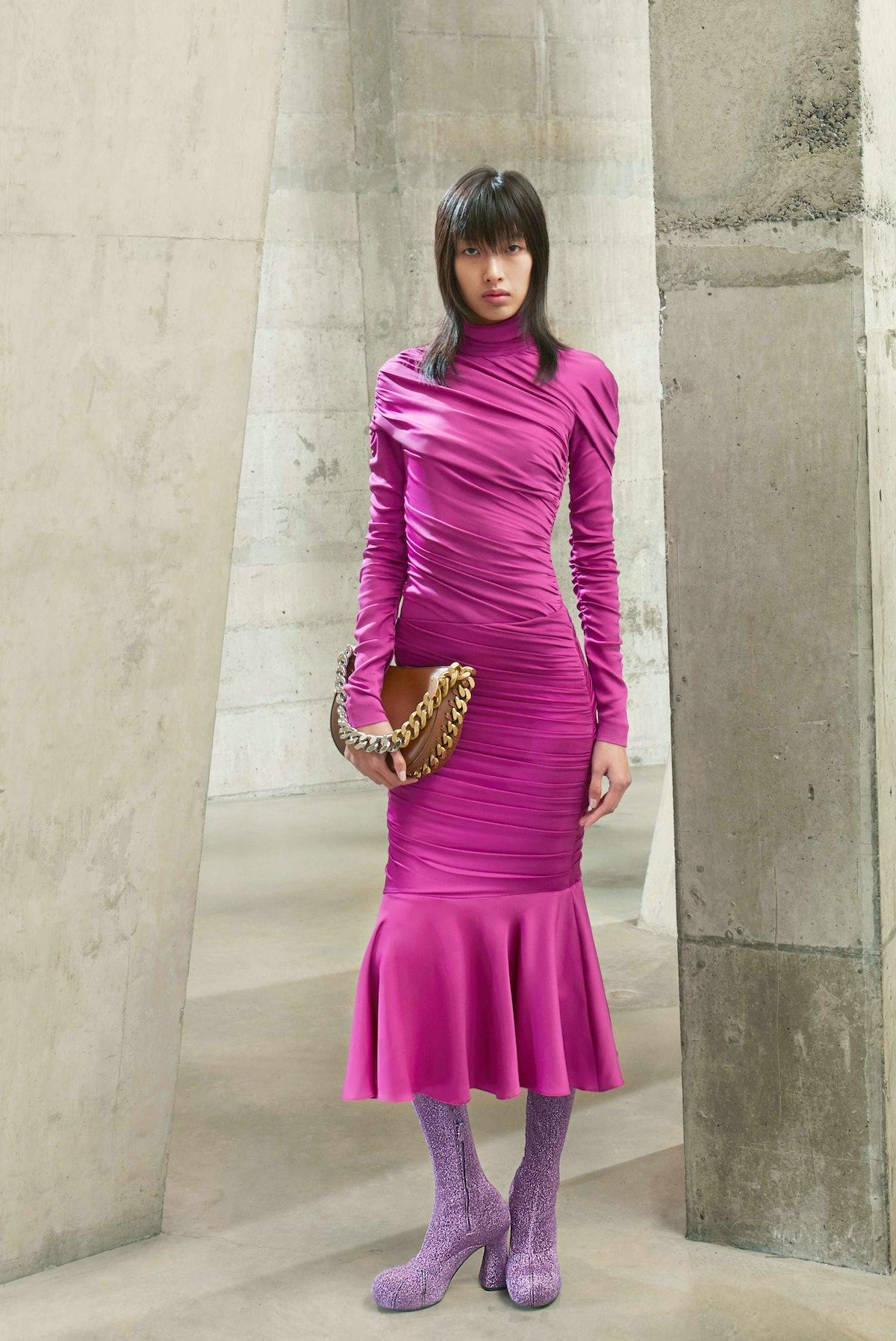 Model in pink turtleneck dress