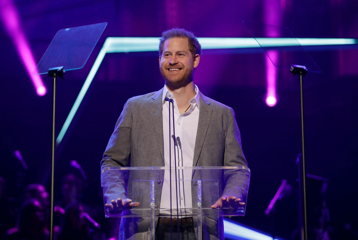 Prince Harry standing at a podium