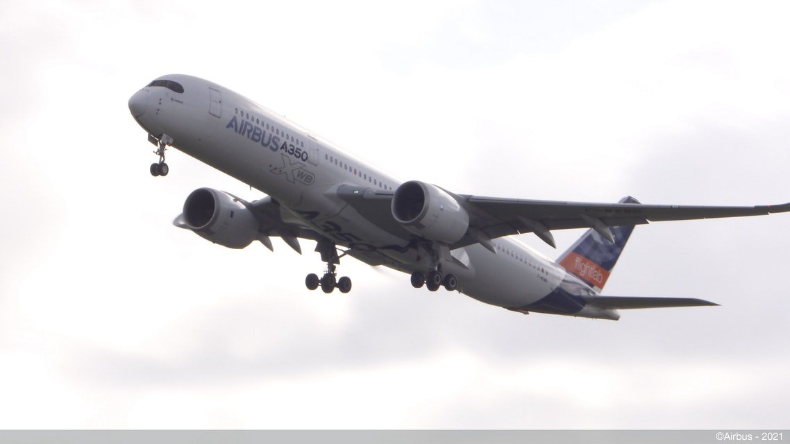 An Airbus A350-900 takes off with 100% SAF on board