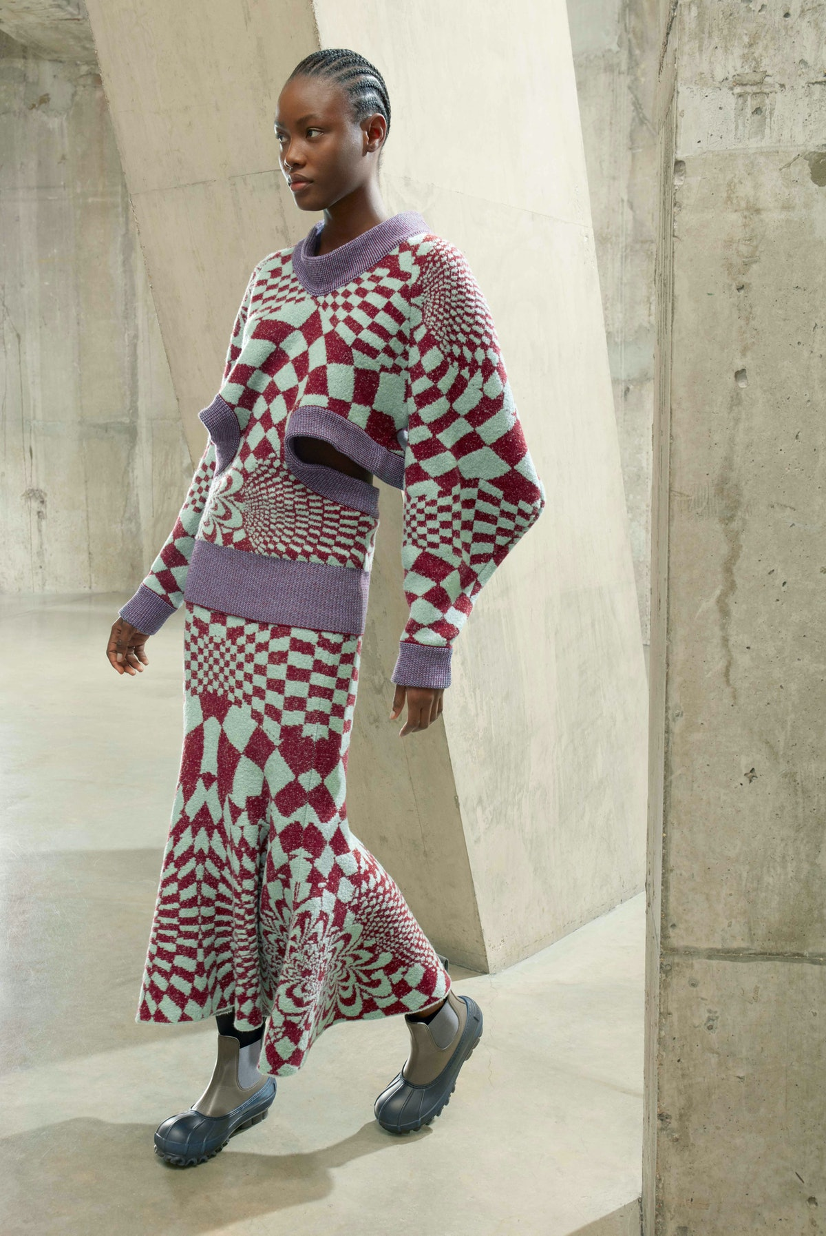 Model in checkerboard knits