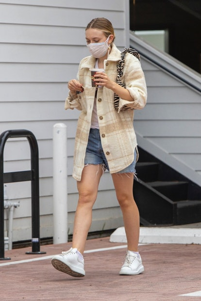 Actor Dakota Fanning was spotted wearing  a checkered Aritzia shirt and TWO MASKs as she exited a nail salon this afternoon in Studio City, CA.