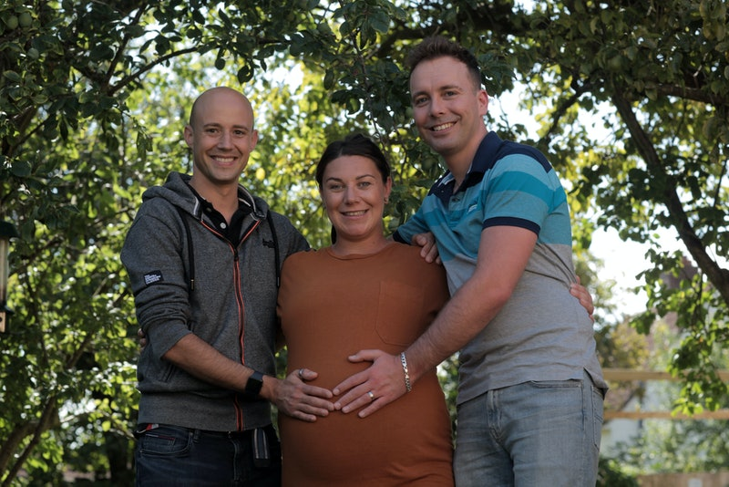 Intended parents, Alex (left) and Rich (right), with their heavily pregnant surrogate, Maddie (middle).