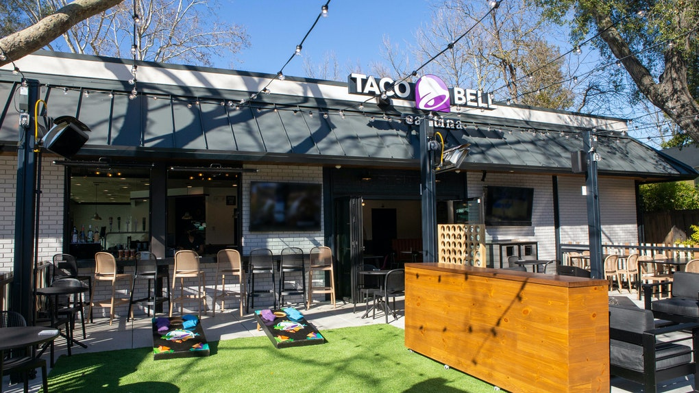 Taco Bell's drive-thru Cantina with a fire pit and cornhole is the first of its kind.