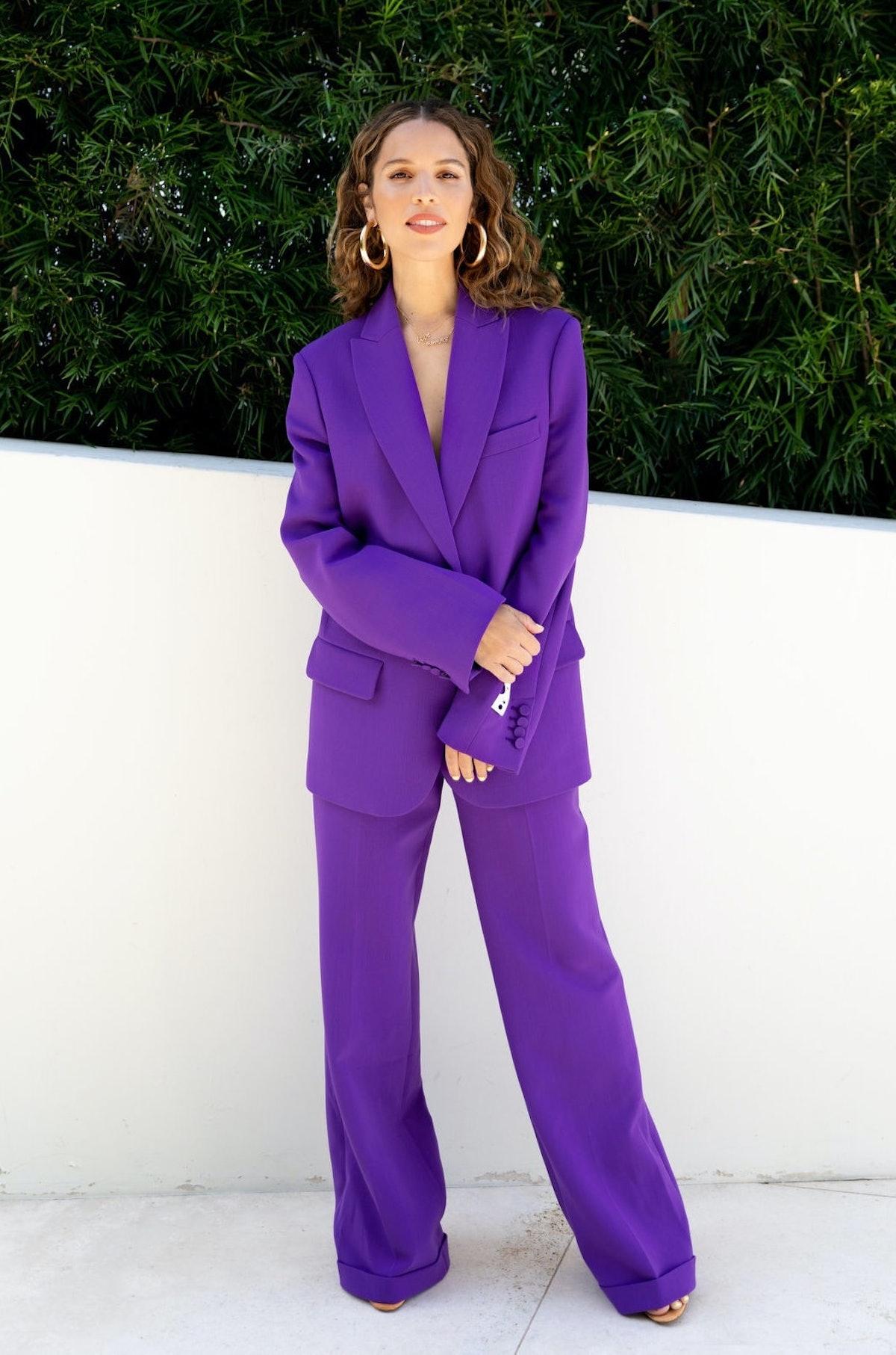 Cleo Wade in purple suit
