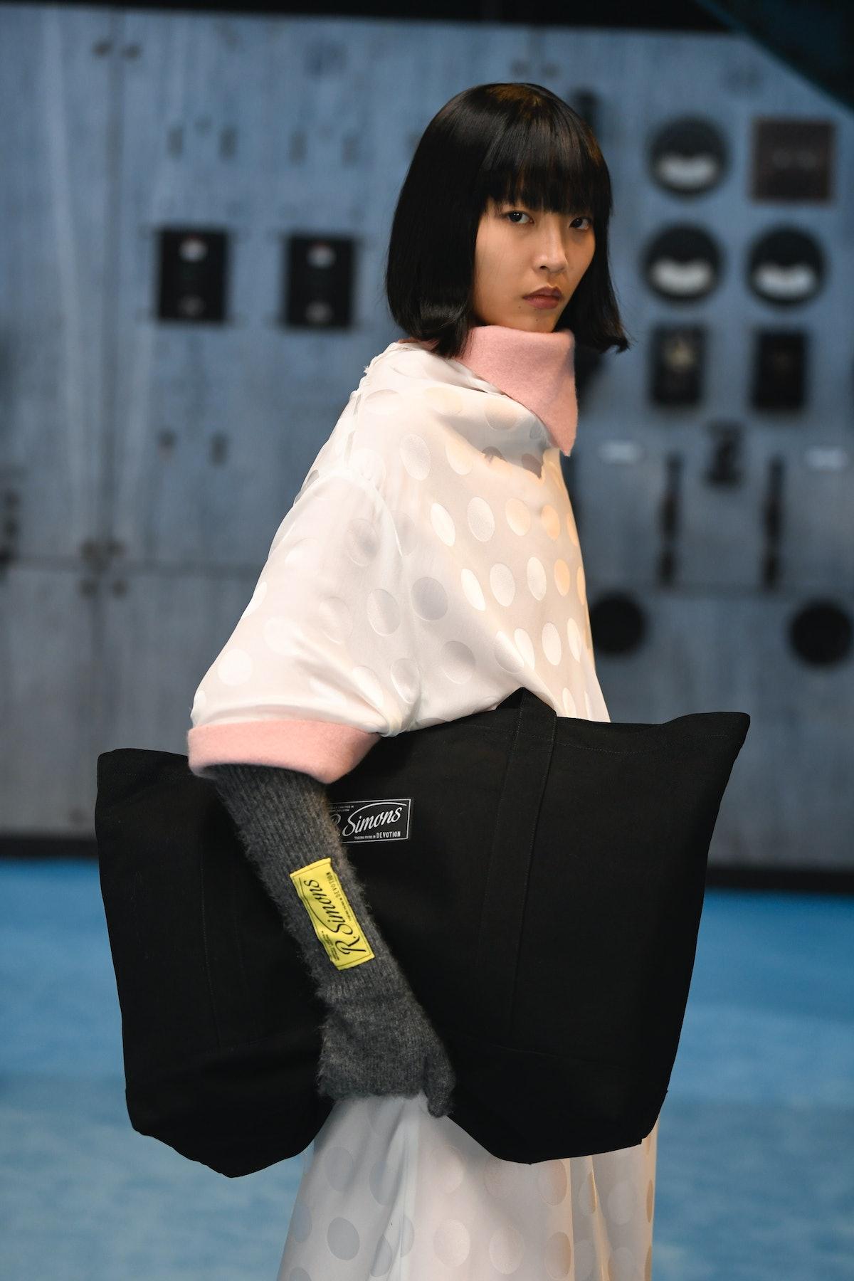A model wearing Raf Simons fall 2021