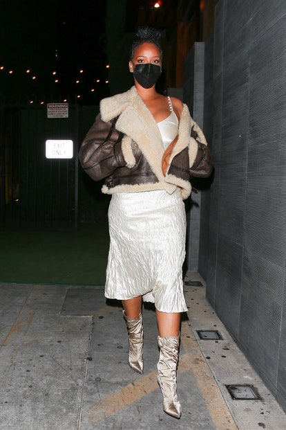 Rihanna was seen leaving Nobu restaurant in West Hollywood after dinner in a white dress and boots, ...