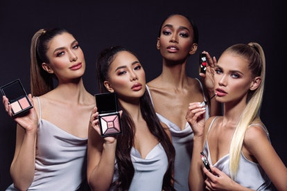Four women show off the House of Sillage's Disney makeup collection that includes lipsticks, eyeshad...
