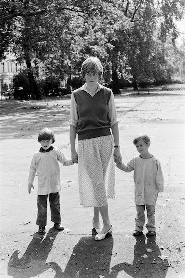 Lady Diana Spencer (Princess Diana) holding hands with students