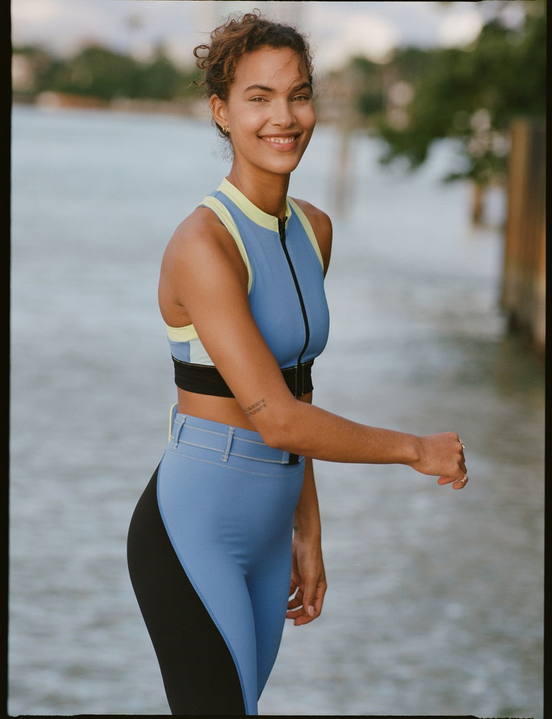 Model Jessica Strother wearing leggings and sports bra from Solid & Striped Sport collection, now available on Bandier.
