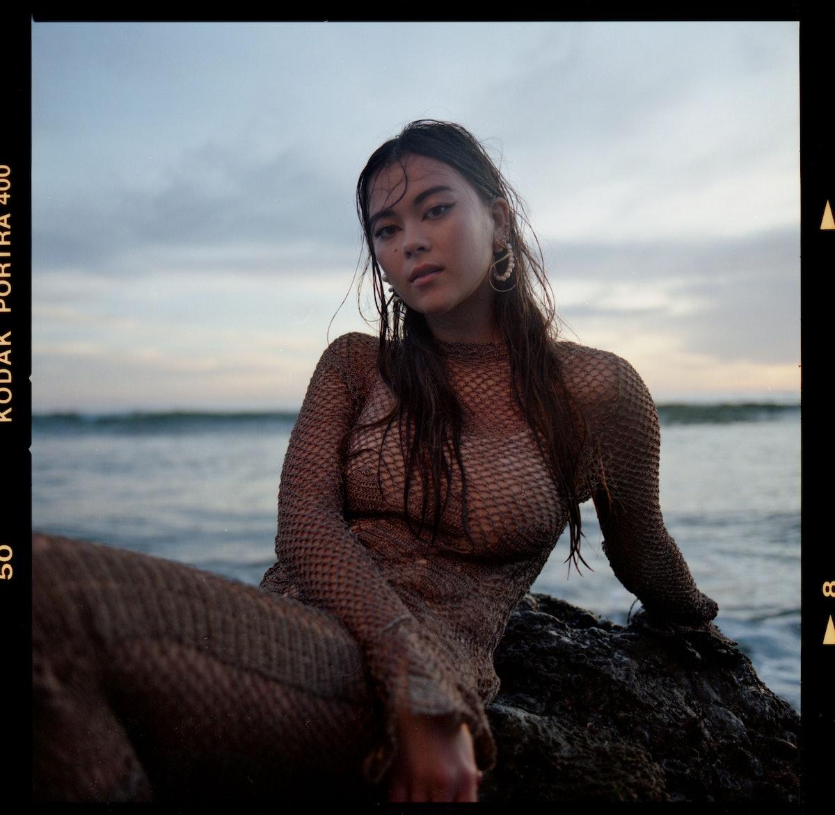 Lukita Maxwell posing on the beach