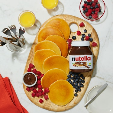 A pancake board is decorating with fruit and Nutella, in support of Nutella and Williams Sonoma's vi...