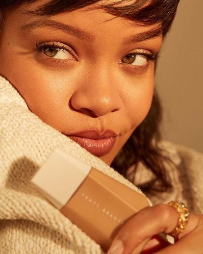 Rihanna wearing Fenty Beauty's new Eaze Drop Blurring Skin Tint.