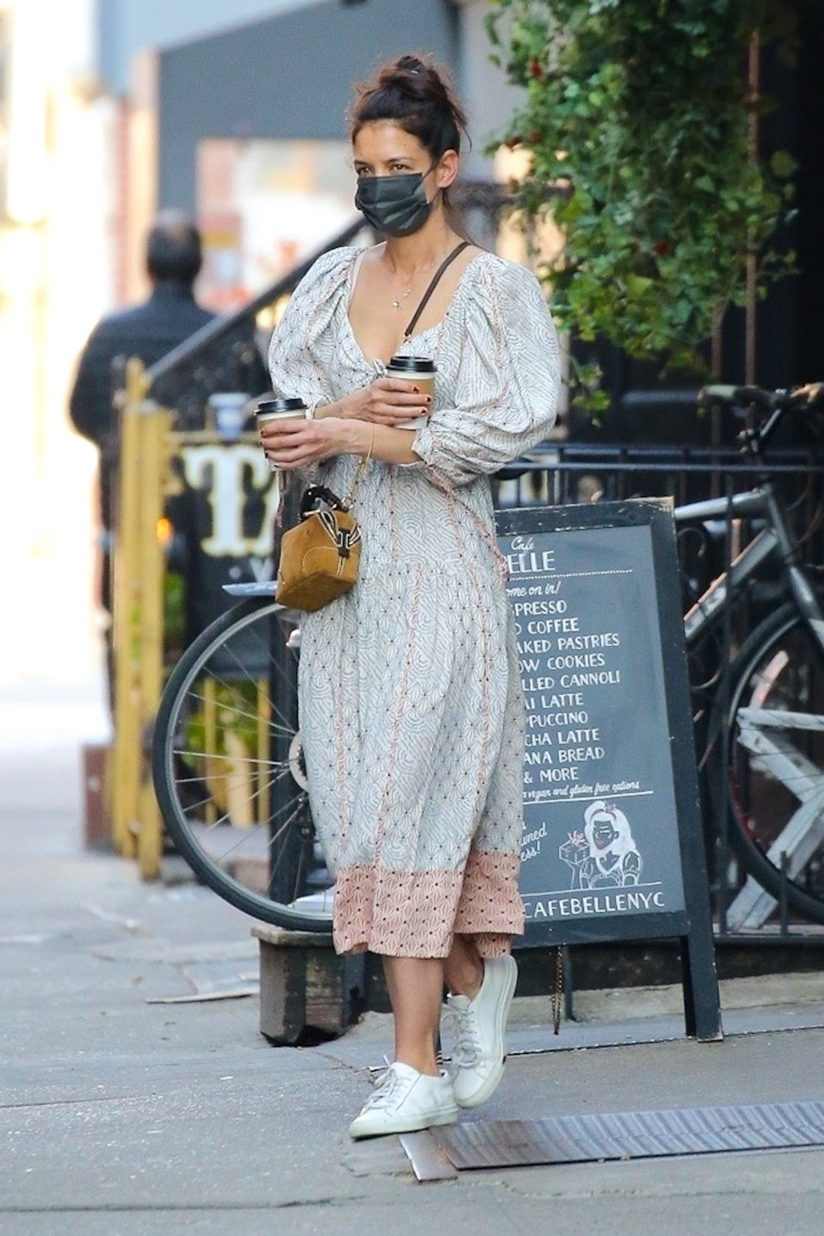 Katie Holmes steps out for coffee rocking a Bohemian chic dress for the occasion. The street style i...