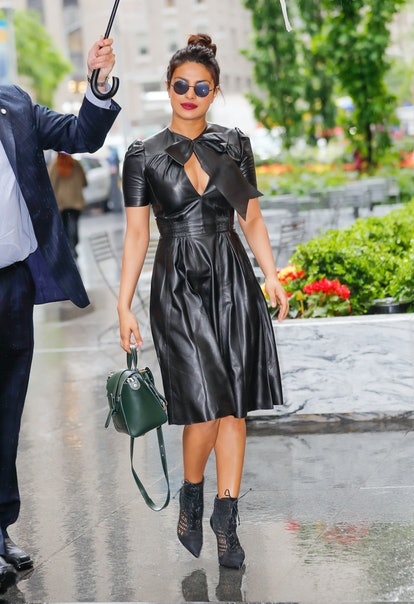 NEW YORK, NY - MAY 22: Priyanka Chopra is all smiles walking under the umbrella when out and about in the rain promoting 'Baywatch' on May 22, 2017 in New York City.