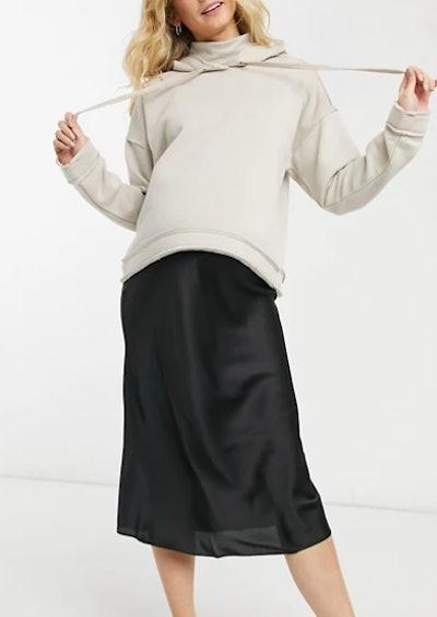 ASOS DESIGN Maternity satin bias slip midi skirt in black
