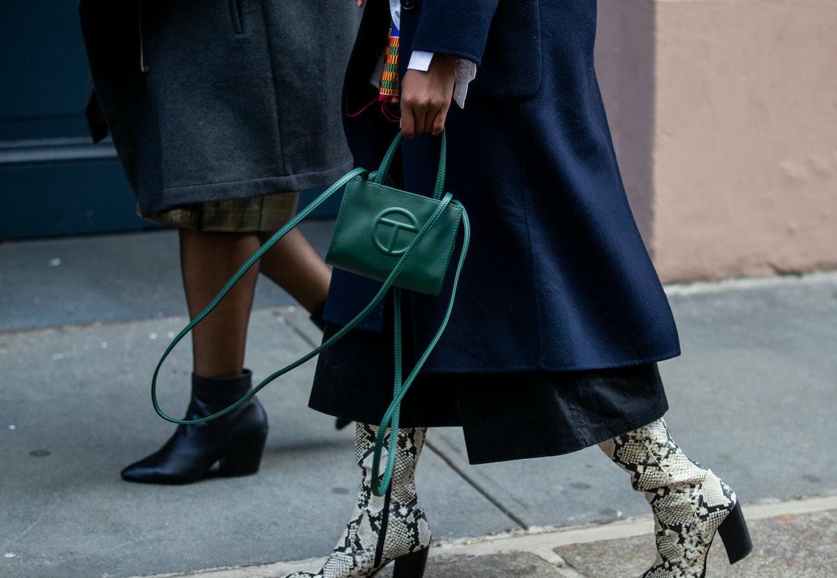 A person carrying a green Telfar bag