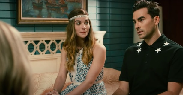 Alexis and David Rose sit on a bed at the Rosebud Motel in 'Schitt's Creek.'