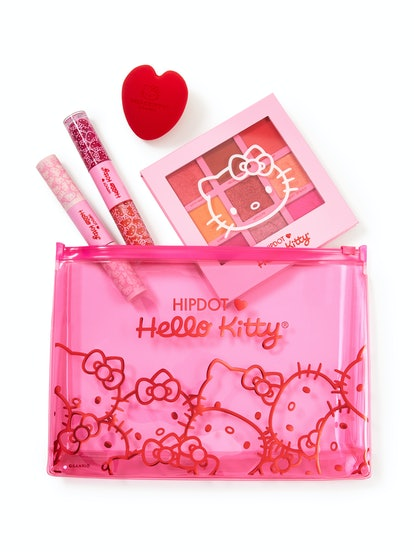 HipDot x Hello Kitty collection pink bag, with products including makeup sponge and palette spilling out
