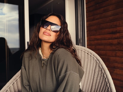 Ashley Graham wears a pair of sunglasses from the Ashley Graham x Quay collaboration.